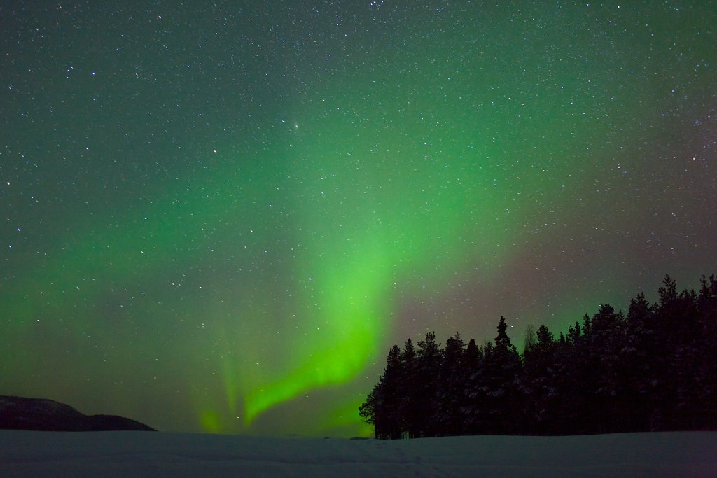 Green curtains of Aurora Borealis