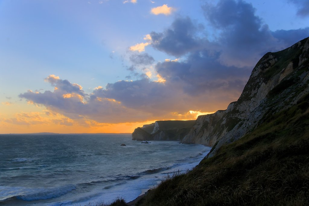 Sun setting behind the Jurassic coast UK